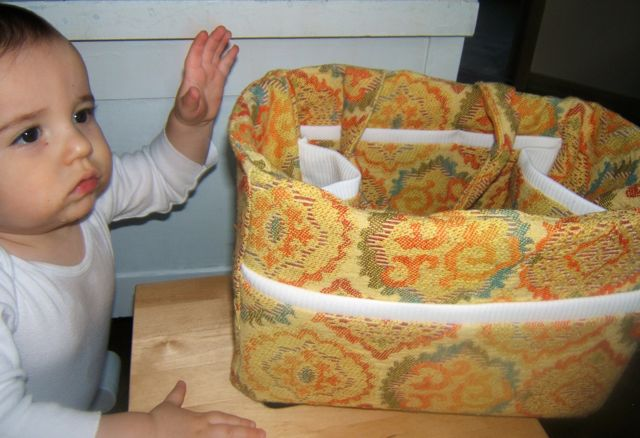 Baby interested in the Herbal First Aid Kit bag